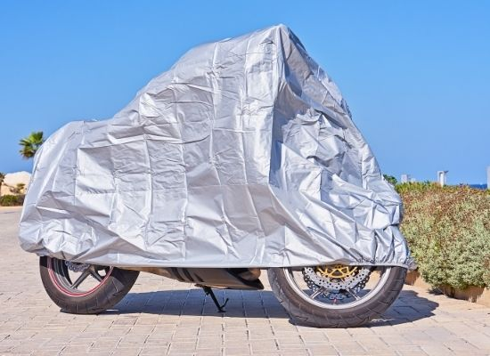 Motorcycle covered with a gray UV protected Cover